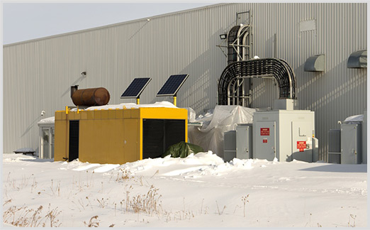 Power generators covered in snow