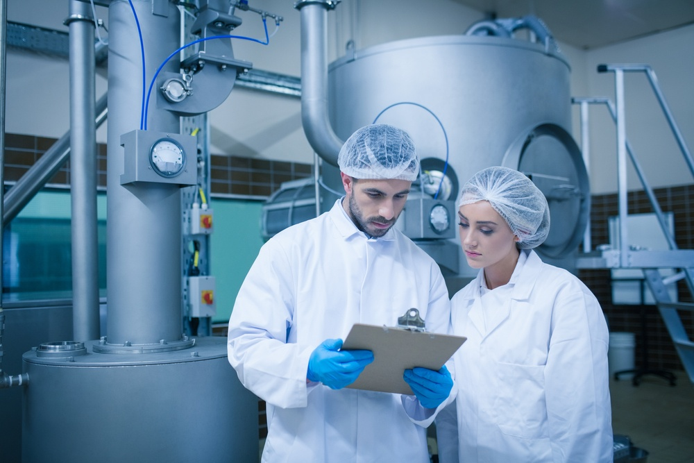 Food technicians working together in a food processing plant.jpeg