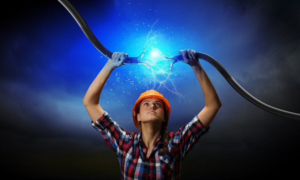 Image of woman holding electricity cable above head.jpeg